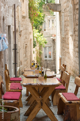 Fotografie, Obraz  Traditional sidewalk restaurant in Korcula, Croatia