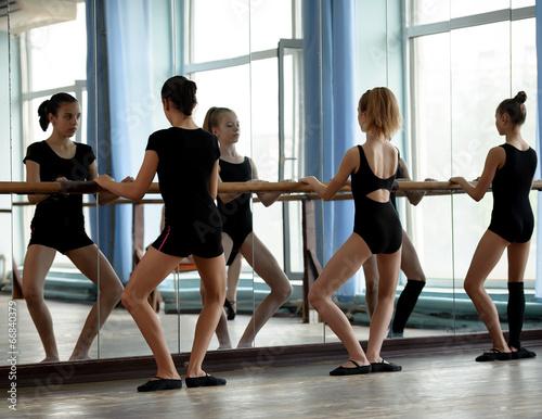 Ballet dancers warming up плакат