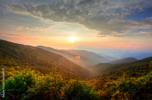 Sunset in the mountains Poster