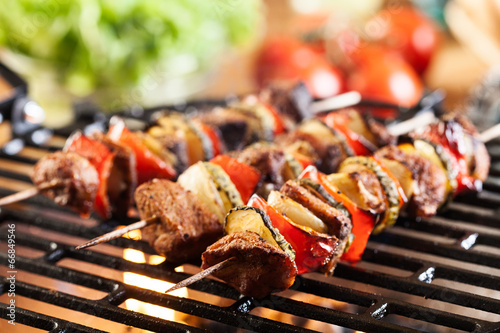 Grilling shashlik on barbecue grill Canvas