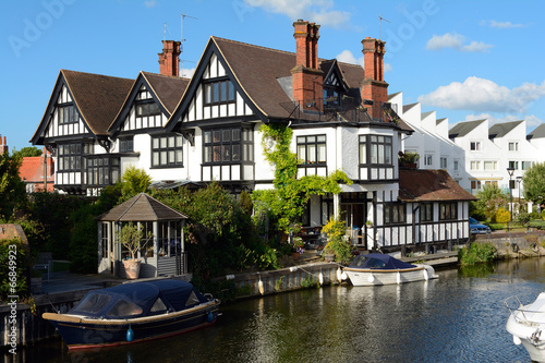 Attractive riverside residence Canvas Print