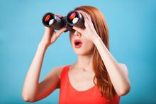 Redhead Girl With Binocular On...