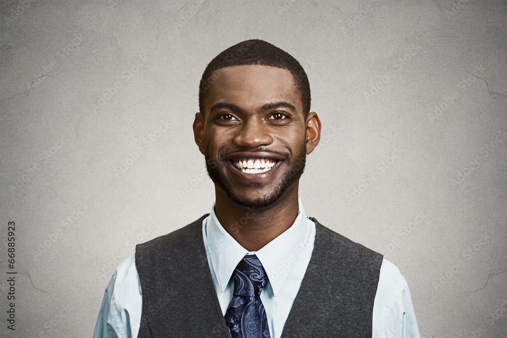 Fototapeta Portrait happy, smiling corporate executive grey wall background