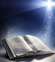 Open Bible With The Wind Of God's Word