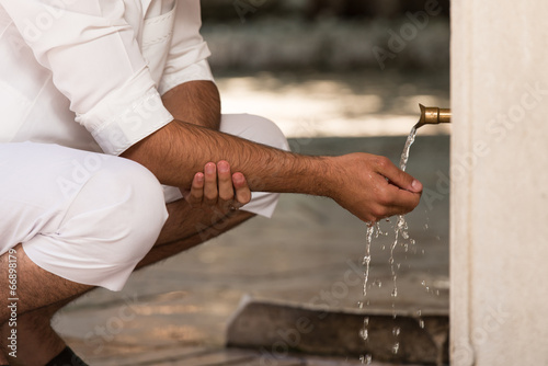 Valokuva  Islamic Religious Rite Ceremony Of Ablution Hand Washing