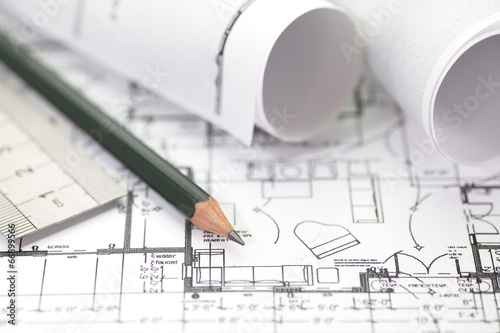 Fotografie, Tablou Architect rolls and plans construction project drawing