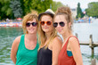 three young women make tourism in Annecy