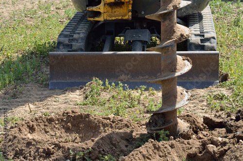 Fotografia  Construction drill with digger