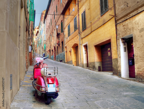 Valokuva  Vintage scene with Vespa on old street, siena, italy