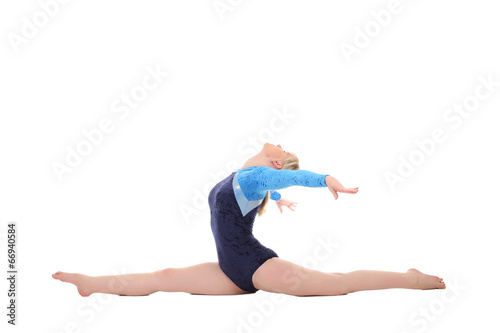 Tuinposter Gymnastiek young girl performs gymnastic exercises
