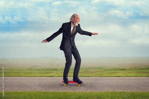 senior man riding a skateboard