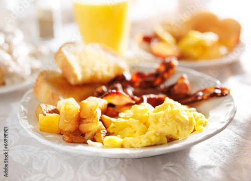 full breakfast with scrambled eggs, fried potatoes and bacon, Fototapeta