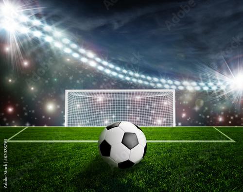 Fototapety, obrazy: Soccer ball on green stadium arena