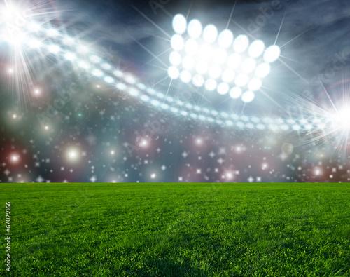 Foto op Plexiglas Stadion Soccer ball on green stadium arena