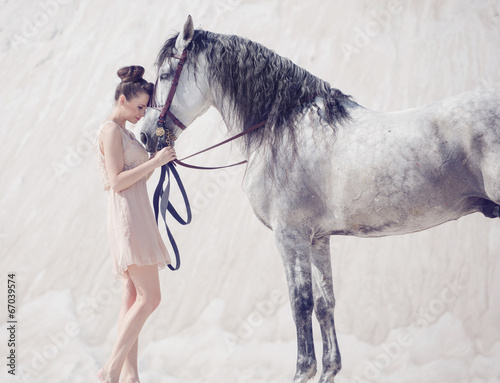 Printed kitchen splashbacks Artist KB Beautiful young woman hugging the horse