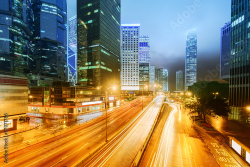 Fototapety, obrazy: the light trails on the modern building background in hongkong c