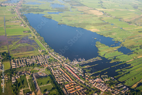Photo  Aerial view over the lake. Amsterdam suburbs