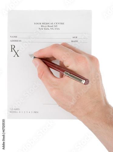 Fotografia  Doctor filling in empty medical prescription
