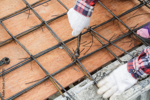 Worker bending steel Poster