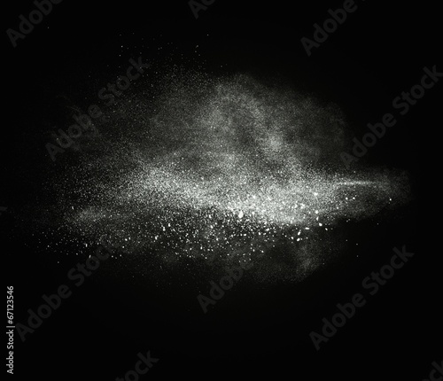 Poster Universe White powder exploding isolated on black