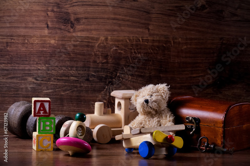 Fotografie, Obraz  collection of old wood children toys with teddy bear