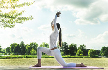 Pretty Woman Doing Yoga Exerci...