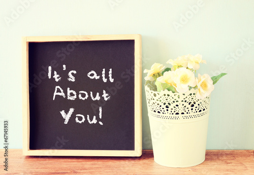 blackboard with the phrase it's all about you written on it. ove Fototapet