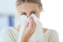 Young Woman With Cold Blowing Her Runny Nose