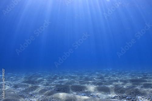 Staande foto Zee / Oceaan Underwater background - sunlight on ocean floor