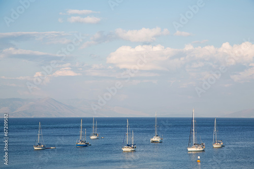 Garden Poster Water Motor sports Blue water and sky background on the ocean with sailing boats.