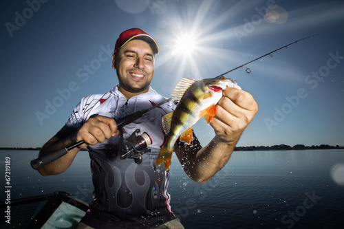 Printed kitchen splashbacks Fishing Happy angler with perch fishing trophy