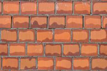 Orange Hollow Clay Block In Fresh Mortar, Wall Background
