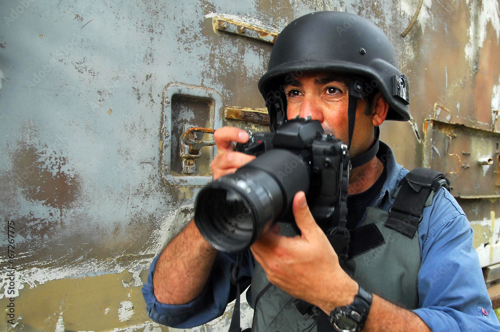 Fototapeta Photojournalist documenting war and conflict
