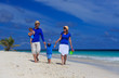 family with kids on tropical beach