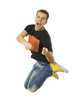 Portrait of an excited young man jumping - Isolated on white.