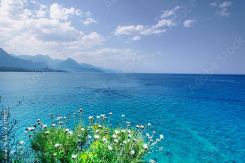 Beautiful seascape with sea, clouds and mountains Poster