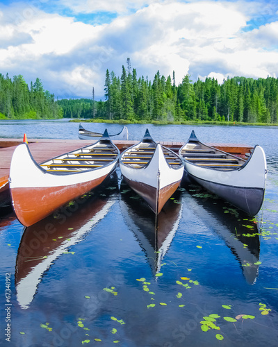 Spoed Foto op Canvas Canada Canoes reflected on a turquoise lake, Quebec, Canada