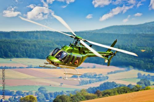 Tuinposter Helicopter Hubschrauber in der Kurve