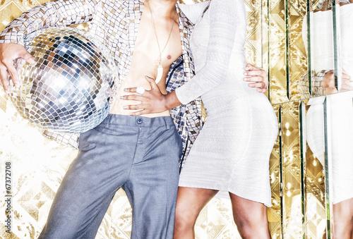 Fotografia, Obraz  70s disco style couple posing with mirror ball