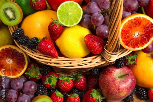 Foto op Aluminium Vruchten Mix of fresh fruits on wicker bascket