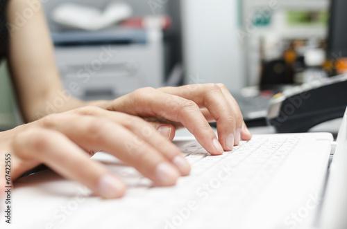 Poster Yoga school Fingers on the laptop keyboard