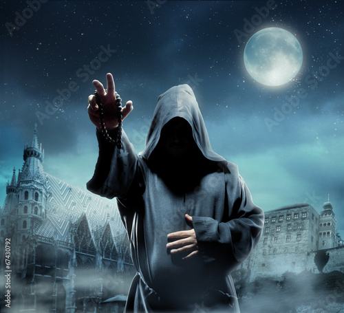 Obraz na płótnie Medieval monk at night
