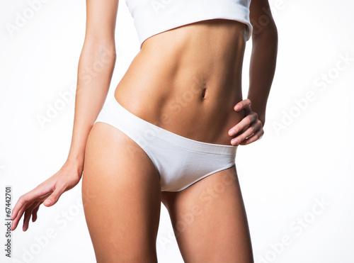 Fotografie, Obraz  Beautiful slim body of a woman in lingerie