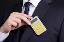 Business Man Putting Calculator Into Pocket