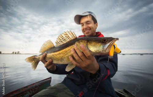 Printed kitchen splashbacks Fishing Happy angler with zander fishing trophy