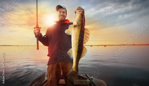 Printed kitchen splashbacks Fishing Happy angler with zander fishing trophy