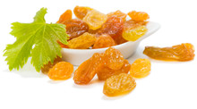Yellow Raisins Or Sultanas In A Small White Ceramic Bowl