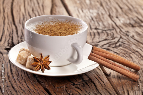 Photo Stands Coffee bar Cup of cappuccino decorated with spices.