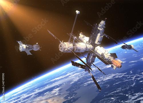 stacja-kosmiczna-i-dwie-satelity-na-orbicie-ziemskiej