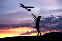 Boy Flies A Toy Plane.